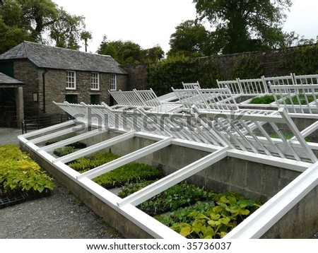Traditional cold frames for wintering plants - stock photo