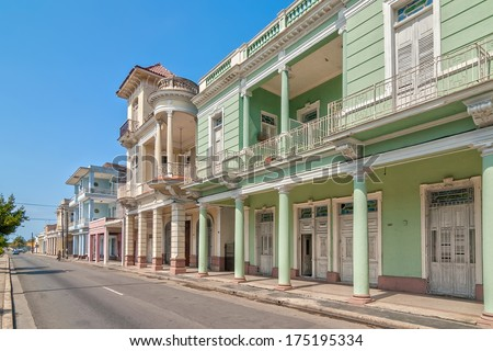 Traditional colonial style colored buildings located on main street Paseo el Prado in Cienfuegos, Cuba - stock photo
