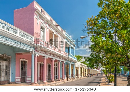 Traditional colonial style colored buildings located on main street Paseo el Prado in Cienfuegos, Cuba