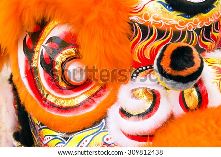 Traditional colorful Chinese dancing lion head decoration - stock photo