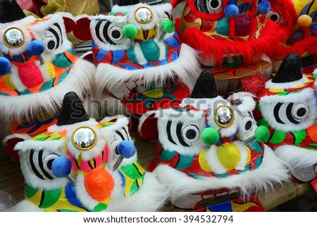 Traditional colorful chinese lion, Chinese paper means - stock photo