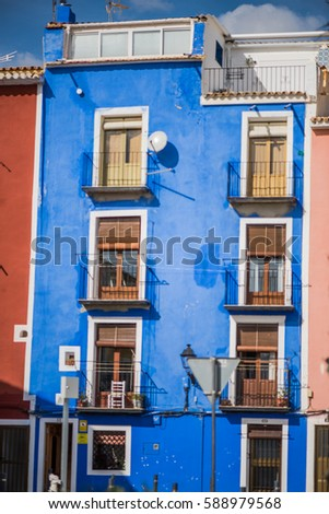 Traditional colorful facades in Villajoyosa in Spain. Famous tourist destination.