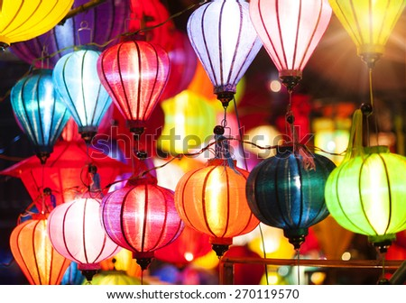 Traditional colorful silk lanterns at market street in Vietnam. - stock photo
