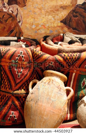 Traditional colorful Tunisian rugs and vase - souvenirs from Africa