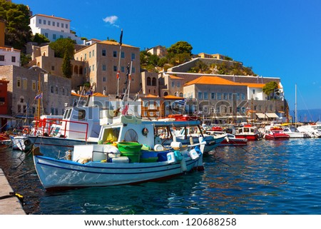 Traditional colorful wooden fishing boats in Greek Island Hydra in Greece Saronikos Gulf - stock photo