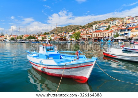 Traditional colourful Greek fishing boat in Pythagorion port, Samos island, Greece - stock photo