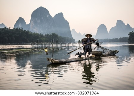 traditional cormorant fisherman on Li river near Xingping, Guangxi province, China. - stock photo