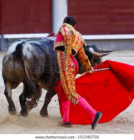 Traditional corrida - bullfighting in spain. Bulfighting has been prohibited in Catalunia since 2011 for animal torturing. - stock photo