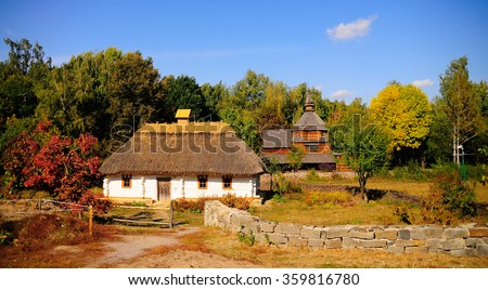 Traditional cottage houses with the straw roofs. Ukraine  - stock photo