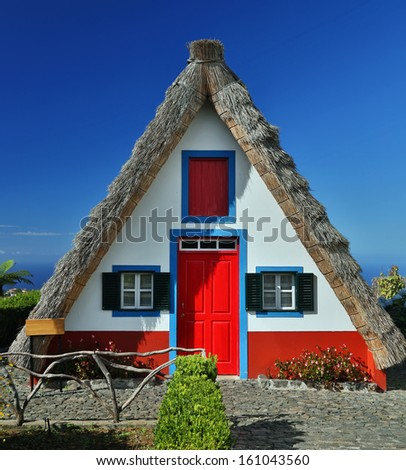 Traditional cottage in Santana (Madeira, Portugal) - stock photo