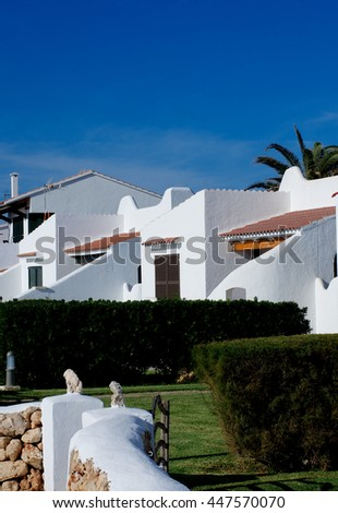 Traditional Country Holiday Houses in Sunny Day on Blue Sky background Outdoors. Balearic Islands, Menorca