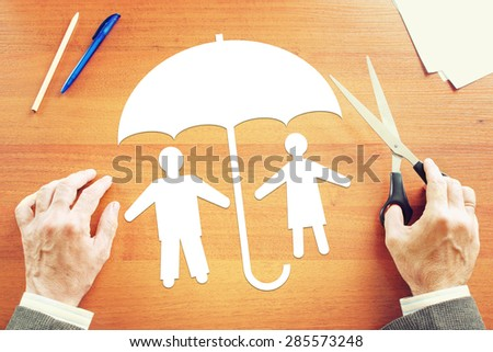 Traditional couple in full safety. Concept of life insurance - stock photo
