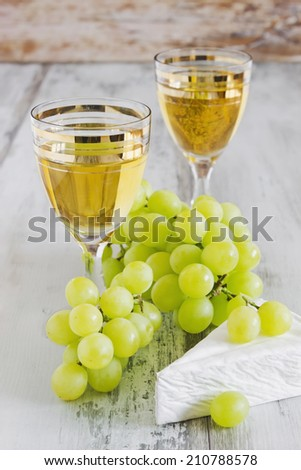 traditional cuisine. grape wine in the glass, brie cheese and grapes. selective focus - stock photo