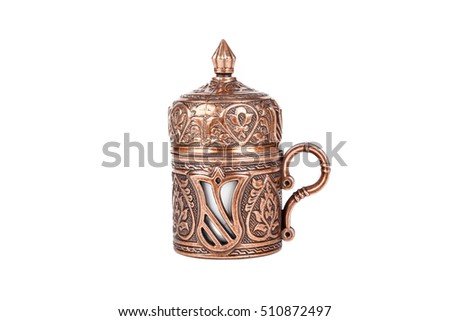 Traditional cup of Turkish coffee, side view, isolated on white background.