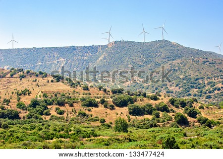 Traditional Cyprus landscape with wind farm - stock photo