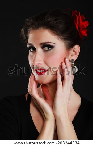 Traditional dance. Portrait of spanish girl attractive woman flamenco dancer performer on black. - stock photo