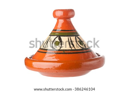 Traditional decorated Moroccan tagine on white background  - stock photo