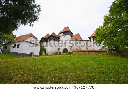 Traditional defense church in Viscri, Romania - stock photo