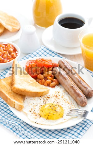 Traditional delicious English breakfast with sausages, vertical - stock photo
