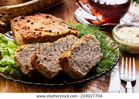 Traditional delicious meat pate with vegetables on a plate - stock photo