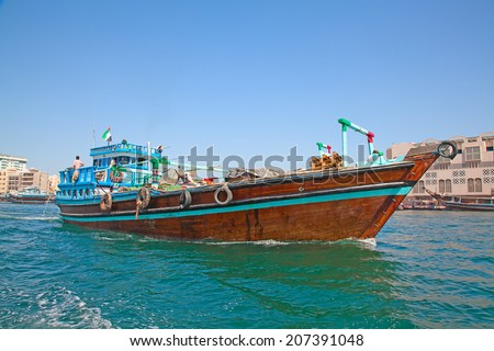 Traditional dhow ferry boats on the Dubai creek - stock photo