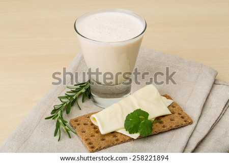 Traditional dietary dairy produkt kefir with napkin and bread - stock photo