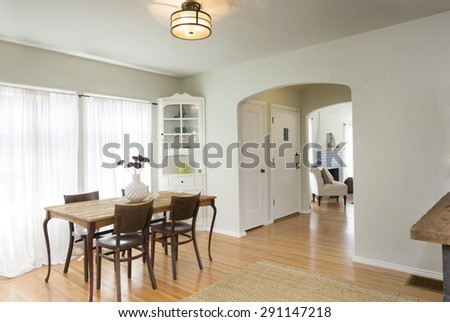 Traditional dining room with wooden table with chairs and built ins.  - stock photo