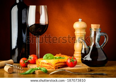 traditional dinner with lasagne bolognese and red wine