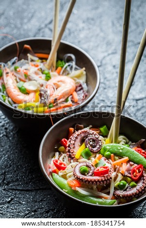 Traditional dish with seafood and noodles - stock photo