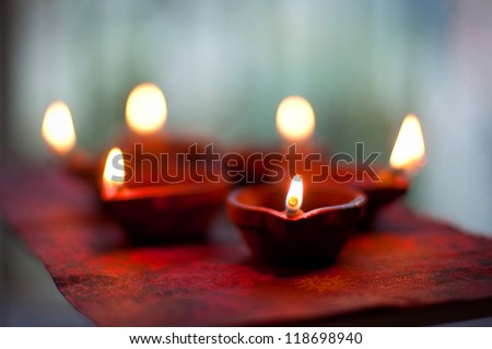 Traditional Diwali lamps and candles lit on the occasion of Diwali festival - stock photo