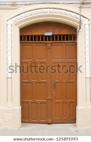 Traditional Door in Old Colonial wall,brown