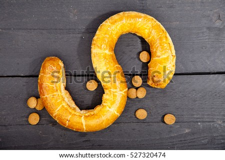 Traditional Dutch cookie Banketletter at Sinterklaas celebration on wooden background