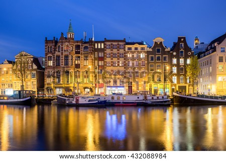 Traditional Dutch houses at night in Amsterdam, Netherlands.