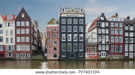 Traditional dutch houses on canal in Amsterdam, Netherlands.