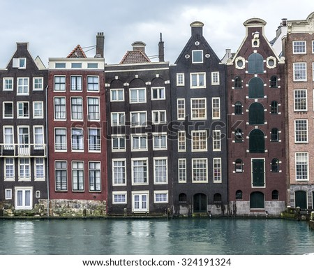 Traditional dutch medieval buildings in Amsterdam, Netherlands.