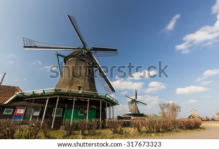 Traditional Dutch old wooden windmill in Zaanse Schans