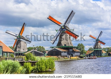 Traditional Dutch old wooden windmill in Zaanse Schans - museum village in Zaandam. The Netherlands. - stock photo