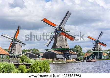 Traditional Dutch old wooden windmill in Zaanse Schans - museum village in Zaandam. The Netherlands.  - stock photo