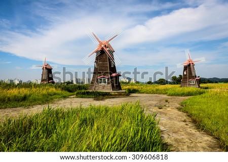 Traditional Dutch old wooden windmill in Zaanse Schans - museum village in Zaandam. The Netherlands in Korea. - stock photo
