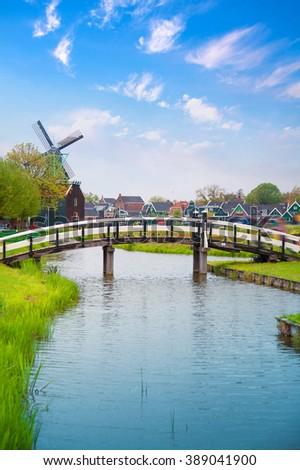 Traditional Dutch old wooden windmill in Zaanse Schans. village in Zaandam. The Netherlands. - stock photo