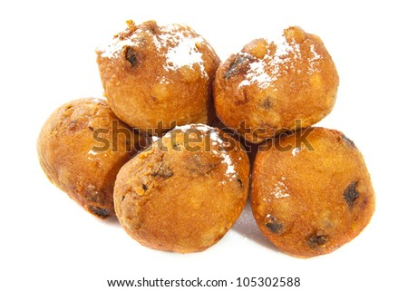 Traditional dutch oliebollen with sugar isolated over white - stock photo