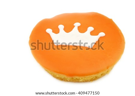 Traditional Dutch pastry with a crown especially produced for King's day on april 27th in Holland on a white background - stock photo