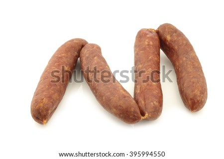 traditional Dutch smoked and dried sausages on a white background - stock photo