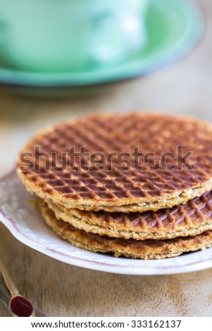 Traditional Dutch waffle called Stroopwafel by coffee