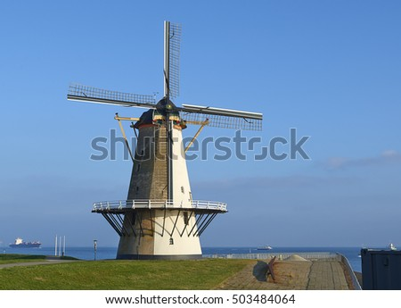 Traditional dutch windmill at the coast