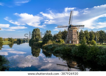 Traditional dutch windmill near the lake in Amsterdam,Netherlands - stock photo