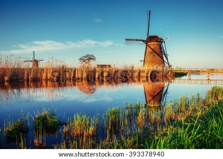 Traditional Dutch windmills from the channel Rotterdam. Holland. - stock photo