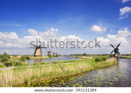 Traditional Dutch windmills on a bright and sunny day at the Kinderdijk in The Netherlands.