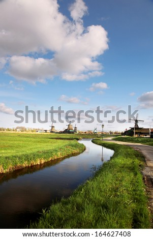 Traditional Dutch windmills with canal near the Amsterdam, Holland - stock photo