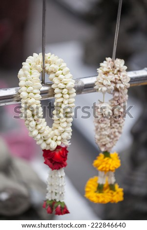 Traditional east asian Buddhist offering made with Marigold flowers, Thailand - stock photo